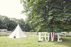 Festival themed wedding at Ridge Farm, Sussex. Photo by Emma Lucy Photography. · Rock n Roll Bride