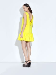 want this dress so much! yellow and neoprene and drop waisted and deep open back... swoon.