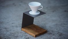 If your main method of making coffee is with a pour-over brewer like the Hario V60, it should have a special home of its own on your countertop. The Pour-Over Stand by JM&Sons fits the bill. It's a simple-but-stylish metal stand with a base made from salvaged barn wood, and fits any pour-over dripper up to 2.5″ in diameter.