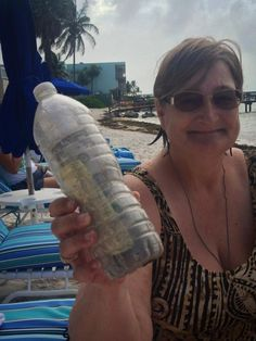 """""""So one of our owners Judi was walking on the beach this morning cleaning up the junk that washed into shore and finds a bottle with a message in it. There is also some sand and 2 one dollar bills. Once we get it open and read the notes we find out that it is in fact NOT sand. It is the ashes of this woman's husband of 27 years named Gordon. She writes that He loved to travel so she sent him traveling in a bottle with a note and money for someone to call home and tell her where he landed. He started at Big Pine Key in March of 2012 and then went to Islamerada where someone found him. They added a note and sent him traveling again and he landed on our beach in Key Colony. Judi called the wife in Tennessee who was excited to know of Gordon's travels! Judi added her note, we put him in a rum bottle (you know added a little fun to his trip) with the three notes. We added another dollar in case Gordon travels far and a long distance call is needed. We will be having a memorial service or celebration of his life on our beach later today before sending him on his way again. Only our sister Judi could find a dead guy on our beach!"""""""