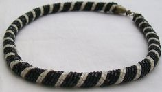 A lovely vintage choker necklace made up of black and white strands of glass bugle beads twisted together in a rope style. Some vintage discolouration to the metal fastener commensurate with age. Circa 1970. Measurement: approx 44 cm long.  Please note: PAY ONLY ONE POSTAGE CHARGE for items bought together in one transaction. Extra items are posted free. This applies to both UK and international postage.   BEFORE YOU BUY, please check out all information on the shipping and policies tab on… Bugle Beads, Strands, Glass Beads, Chokers, Black And White, Trending Outfits, Unique Jewelry, Metal, Bracelets