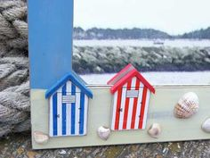 Beach Huts and beach hut accessories in the UK - Coastal decor, beach hut models, beach hut t-lights, nautical t-lights, Beach hut storage boxes, glass beach huts, Beach hut coat hooks, beach hut money boxes, beach hut light pulls, beach hut clocks, glass beach huts, beach hut draught excluders, beach hut light pull and other beach hut accessories for the beach decoration themed home, seaside bathroom, garden or boat.