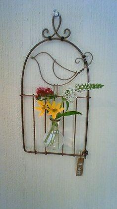 Wire art, bird in cage.