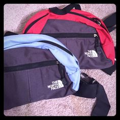North face fanny packs Red and grey & light Blue and Grey North Face Fanny Packs ! Can be sold together or separately ! North Face Bags
