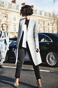 To the left to the left. Sideways sleek. #Yasmin_Sewell in her gorgeous grey coat. Play it again Yaz. #PFW