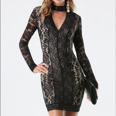 """SALE Bebe Lace Panel Mock Neck Dress S/P This gorgeous front & back V-neck dress from Bebe features exquisite lace paneling and a sleek mock neck.  It has a hidden back zip, button-loop closure at the neck & is partially lined.  Made of 90% nylon & 10% spandex it stretches nicely to hug your body in all the right places.  The center back to hem measures 23 1/2"""", the front measures 25"""" from center of V-neck to bottom & 15"""" from armpit to armpit.  Worn only once it is in like new condition…"""