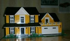 Yellow LEGO House by LegoPredator on mocpages.com.  A very nice traditional style home.
