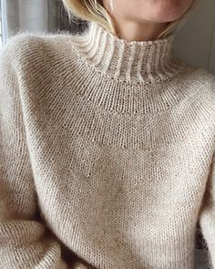 The Novice Sweater is knit seamlessly from the top down. That means that you will begin by knitting the neckband, then the yoke, then the body, and finally the sleeves. The sweater is knit in stockinette stitch, while the neckband, bottom edge (waist band), and cuffs are knit in rib.