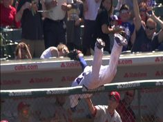 Rizzo's tough catch  8/18/13: Anthony Rizzo runs into foul ground and makes a tough catch on a popup, fully extending over the Cardinals' dugout to make the grab
