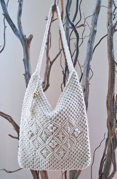 This macrame shoulder bags is brand new and never used. Macrame first became popular in the 70s. This one is short and hangs just under the armpit