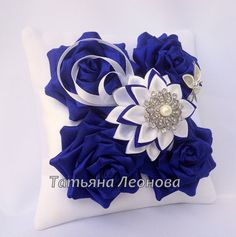 The pad is made in the blue scale, jewelery and decorated with rhinestones. The model can be made in any color of your choice. Baby Sensory Board, Toddler Activity Board, Venus, Kanzashi Tutorial, Ring Pillows, Invitation, Crochet Cushions, Cloth Flowers, Fuchsia