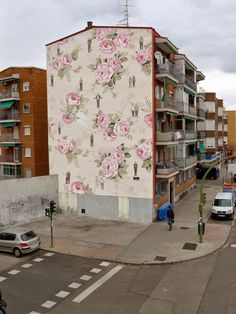 INSIDE OUT: ESCIF PAINTS FLORAL WALL PAPER FOUND INSIDE A BUILDING ON THE OUTSIDE