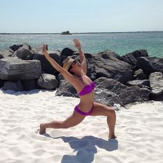 Elizabeth from The Bar Method Montclair gets low in runner's lunge on the beach. #WhereDoYouBar?