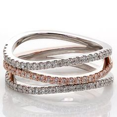 Pink Fuego - Pink Fuego has a delicate balance of warm 14k rose gold and crisp white gold. The serene wave of the three micro pavé diamond bands accent the graceful flow of the ring. For a comfortable fit, the bands are joined as one at the bottom of this wide and airy band.