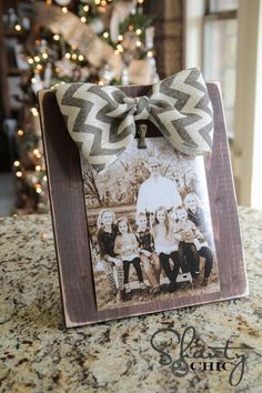 DIY Bow Photo Frame... I think this is so simple and cute (And only $3?!?!)