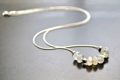 """moonstone and Thai silver beaded necklace, 16"""" silver snake chain. $29.00, via Etsy."""