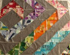 Scrappy HST's by Needle and Foot. Improv piecing and saturated color!