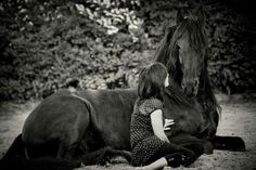 The photo of this Friesian and his owner touches my heart!