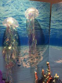 Jellyfish - clear plastic bowl, shower cap and iridescent wrapping paper cut in a spiral
