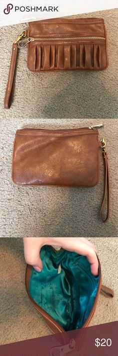 Brown wristlet Brown wristlet from Bakers with gold accents. Teal lining inside. Two outside zippers with inside zipper pocket as well. No stains or tears. Bakers Bags Clutches & Wristlets