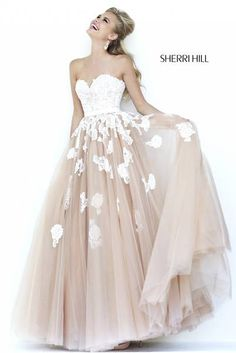 SHERRI HILL Prom Dresses 2015 # 11200 Delicate lace is appliquéd and embroidered on the sweetheart bodice and scattered over the full tulle ballgown skirt.