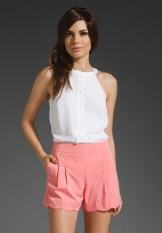 Love high waisted shorts. The pink and scalloped hem is lovely too, and the pretty white top.