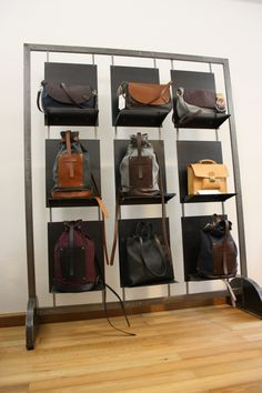 iron structure with backpacks and bags!cremona italy bag in 2 Bag Display, Display Design, Store Design, Display Ideas, Timberland Store, Backpack Storage, Craft Booth Displays, Shops, Store Windows