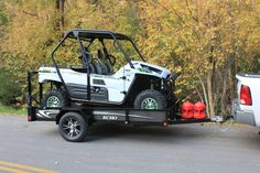 White Machine with 10' Ultimate UTV trailer and Custom white graphics. Shown with optional gas can rack and two (5) gallon cans.