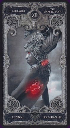 XIII Tarot | The XIII Tarot is very literally a dark deck; illustrated in greys and blacks with highlights in red. The artwork on the major arcana is a little gothic and a little Giger-esque, while the minor arcana have simple arranged pips without scenes.