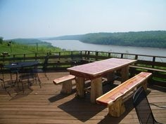 Cedar log table with removable to and log bench seating.View from the OVERLOOK RESTAURANT/WALTERS PUB,   Leavenworth Indiana.