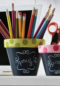 Add some polka dots to these cute DIY chalkboard flower pots -- perfect for holding craft supplies!