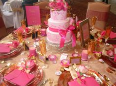 Pink and gold wedding tablescape full on... Like flower tucked in with ribbon tied napkin
