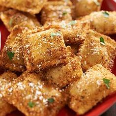 RITZ Fried Ravioli Allrecipes.com - Can do these in a 450 degree oven. Spray each side with cooking spray and bake on a rack on a baking sheet. Flip after 5-6 minutes. Total cooking time 10-12 minutes. Yummo!