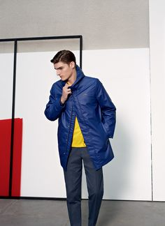 Alexander Beck embraces the fun but sporty spirit of Lacoste Live in a blue coat and bright yellow top.