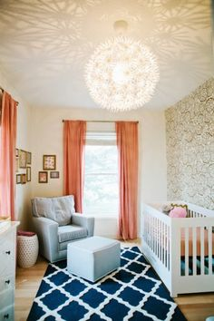 From the geometric rug to the affordable Ikea chandelier to the stunning wallpaper, everything about this nursery is perfection.