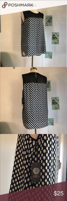 Vince Camuto Polka Dot Sheer Top Blouse Sheer top with polka dots at the bottom. Shirt is longer from the back with slits at the sides. Vince Camuto Tops