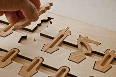 Magnetic Chess Set Made from Laser etched/CNC cut maple, with machine-cut oak pieces. The chess pieces stow away in the underside of the board in individual spots assuring that they're all accounted for. Each piece, as well as the center of each tile...