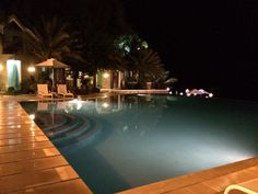Night view of the Infinity Pool Batangas Philippines, Places Ive Been, Places To Go, Beach Resorts, Infinity, Night, Outdoor Decor, Infinite, Vacation Places