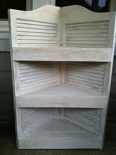 Look what a pair of old swinging saloon doors and some pallet wood can give you in a day! A pretty nice corner shelf!