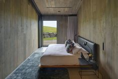This new pavilion-like house designed by Atelier Andy Carson is a sanctuary from its harsh surrounds, perched on a sprawling coastal site overlooking Werri Beach, New South Wales. South Wales, Floating Fireplace, Timber Walls, Wood Walls, Timber House, Modern Barn House, Contemporary Barn, Architect House, Modern Bedroom
