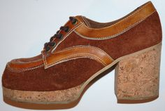 Platform shoes of the 70s,so glad i never broke any bones wearing these in high school,walking up and down all those stairs.I had a black leather pair with a paisley imprint grain on the platform and heel.