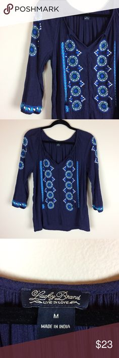 Lucky Brand embroidered blue boho top Condition: Preowned, no holes or stains. Normal wear from washing and wearing  Color: dark blue with shades of blue embroidery   Measurements: Size Medium Underarm to underarm is approximately 21 inches across.  Length from back of neck to bottom of hem is approximately 22 inches.   Materials: material tag removed (bin T) Lucky Brand Tops Blouses