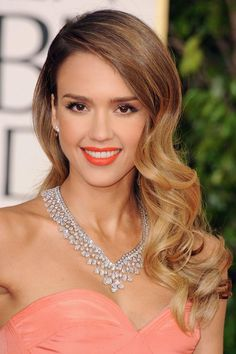 jessica albas hair and makeup went perfect with her salmon colored dress! she looked flawless