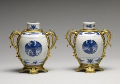 Pair of Blue and White Jars with Three Peonies and Symbols.Porcelain: Kangxi period,1675-1725; Mounts: mid 18th century. Porcelain with underglaze blue and French ormolu mounts,6 1/2 in. (16.5 cm). Acquired by William T. or Henry Walters.49.1023, 49.1024. The Walters Art Museum