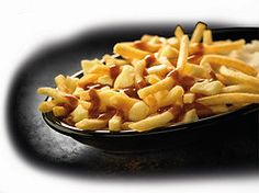 McDonald's Canada - Poutine....French Fries w/gravy    @mcdonaldscorp These would be a big hit in Louisiana. I had some in Toronto last year, want more.