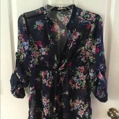 Express: light weight button up floral print top Express: very light weight. Sheet button up. Adjustable long sleeve. Loose fit with cinching. Button up. Floral print. Great condition. Express Tops Blouses