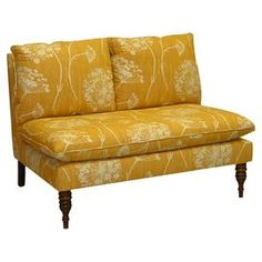 "Pine wood and foam settee with floral-print upholstery. Handmade in the USA.Product: Settee  Construction Material: Solid pine frame, polyurethane foam and polyester fill foam  Color: Butterscotch   Features: Handmade in the USA  Dimensions: 35"" H x 49"" W x 35"" D  Cleaning and Care: Spot clean only"