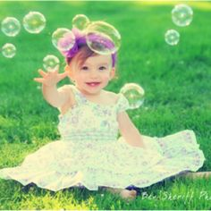 Little girl playing with bubbles picture. #photography