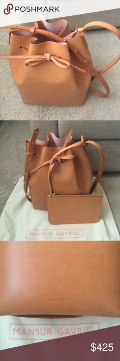 Mansur Gavriel bucket bag in Cammello/Rosa Highly sought-after Mansur Gavriel bucket bag. It is made in Italy using Italian vegetable tanned leather. This like new bag has only been used for a few times. It also comes with a detachable matching pouch, and is in its original dust bag. Measures is 12.25Hx10Wx6D. Mansur Gavriel Bags Crossbody Bags
