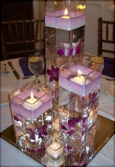 Wodnerful DIY Unique Floating Candle Centerpiece With Flower Wedding Flowers, Beautiful And Inexpensive Purple Wedding Centerpieces: inexpensive wedding flowers. wedding flowers Wodnerful DIY Unique Floating Candle Centerpiece With Flower Purple Wedding Centerpieces, Floating Candle Centerpieces, Diy Centerpieces, Wedding Decorations, Quince Decorations, Table Decorations, Inexpensive Centerpieces, Homemade Wedding Centerpieces, Turquoise Centerpieces